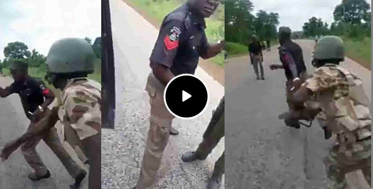 Nigeria Soldiers Beat Policemen Extorting Motorists And Cyclists On Aba Road {Video}